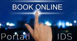 hand pushing book online button on touch screen